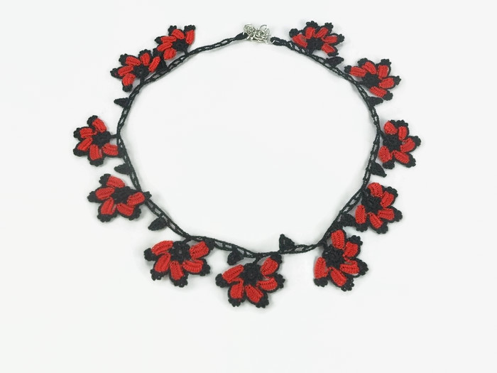 necklace with red and black flowers